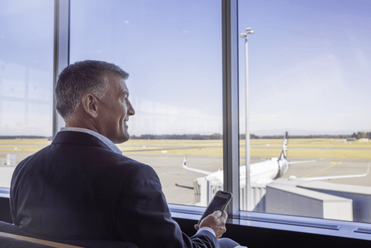 chc-airport-man-at-gate-on-mobile-4435-1200x800