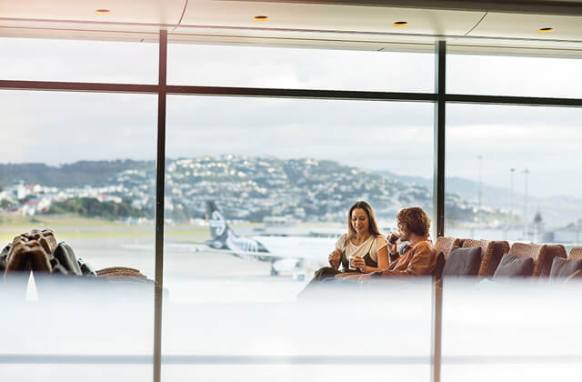Air New Zealand couple in koru lounge