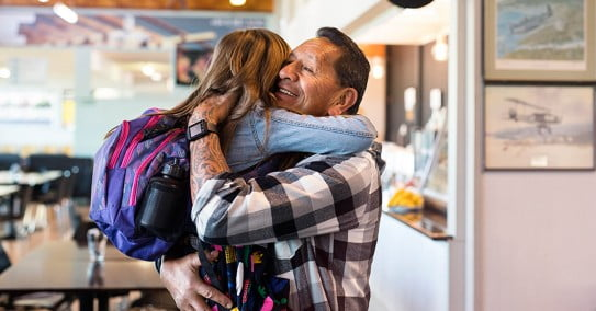 Air New Zealand girl hugging granddad