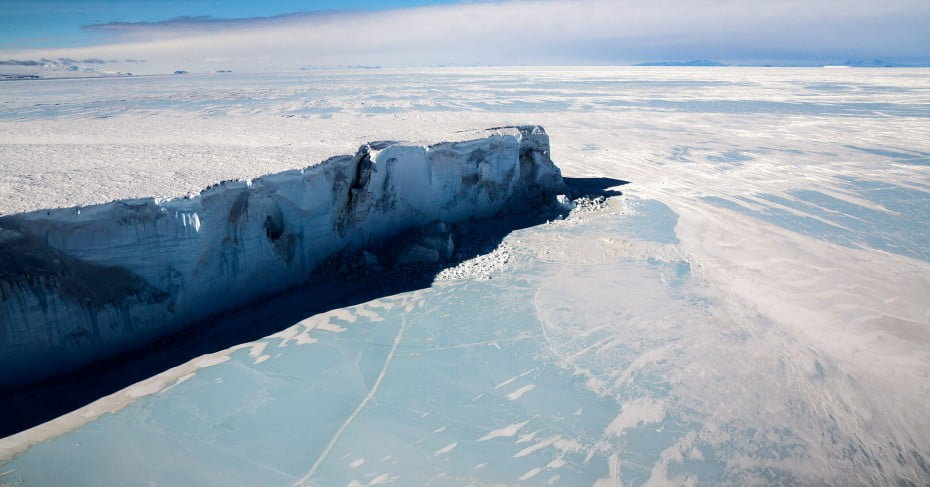 Iceberg trapped in frozen sea ice McMurdo Sound, Antarctica.