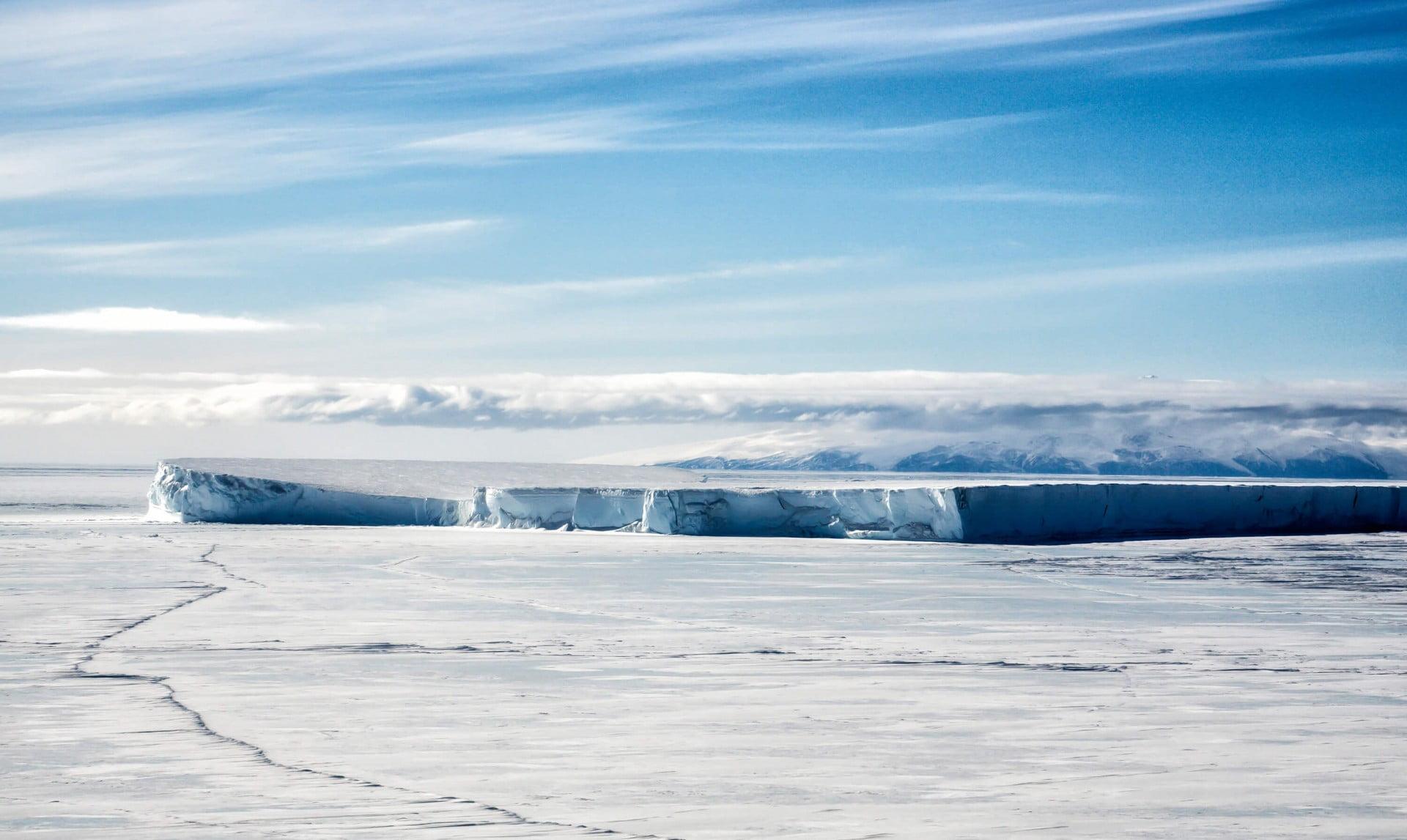 Iceberg trapped in frozen sea ice McMurdo Sound, Antarctica.