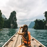 Woman photographing, Khao Sok National Park, Thailand.