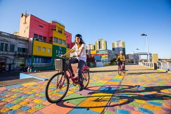 Riding bicycles in a colourful street, Buenos Aires, Argentina.