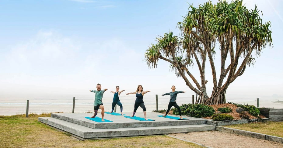 Group yoga at sunrise, Elements of Byron Resort & Spa, Byron Bay.