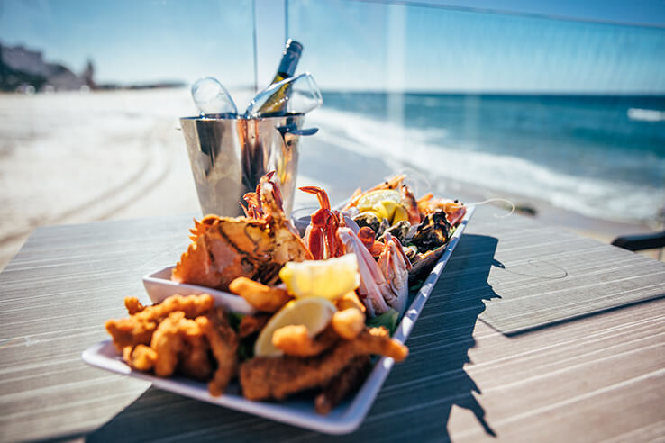 Seafood and wine at Currumbin beachside cafe, Gold Coast, Australia.