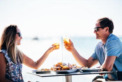 Couple sharing meal, Currumbin, Gold Coast, Australia.