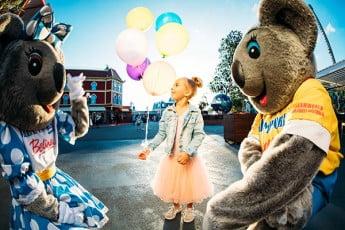 Girl in tutu with balloons, Dreamworld, Gold Coast, Australia.