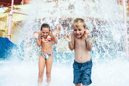 Dreamworld children playing in water in Pipeline Plunge, Gold Coast, Australia.