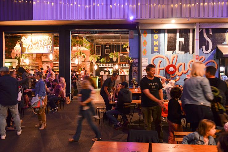 Busy crowd outside a cocktail bar, Miami Marketta, Gold Coast, Australia.