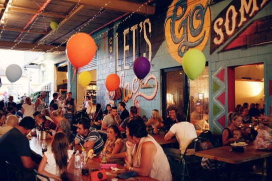 Customers and painted street art mural at Miami Marketta, Gold Coast.