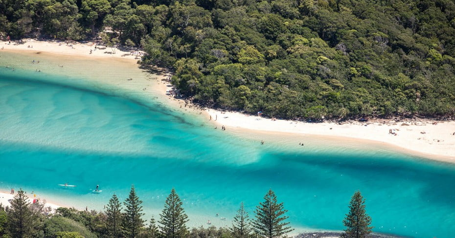Aerial of people at Tallebudgera Creek, Australia.