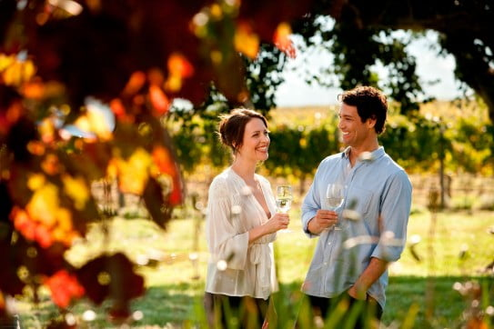 Couple drinking wine in Yarra Valley, Melbourne, Australia.
