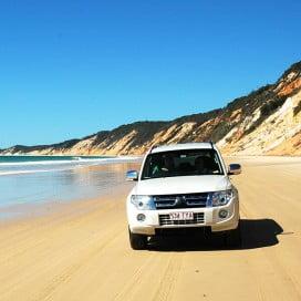 4WD down Rainbow Beach, Sunshine Coast, Australia.
