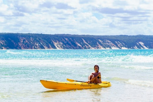Lady in canoe, Rainbow Beach, Sunshine Coast, Australia.