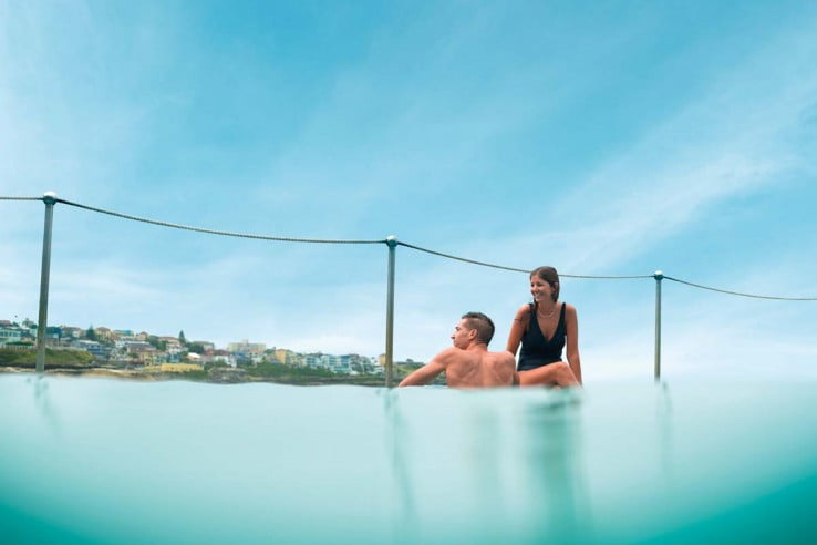 A couple enjoying an ocean pool, Sydney.