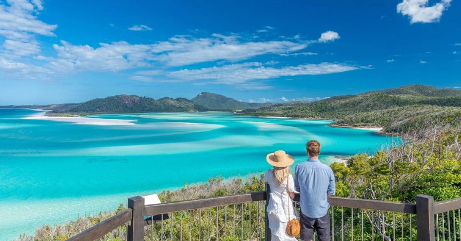 Couple overlooking hill inlet, Whitehaven Beach, Australia.