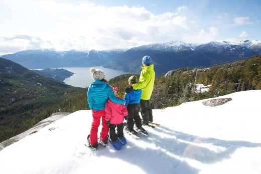 Family in snowshoes, Vancouver, Canada.