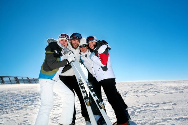 group of skiers on a mountain.