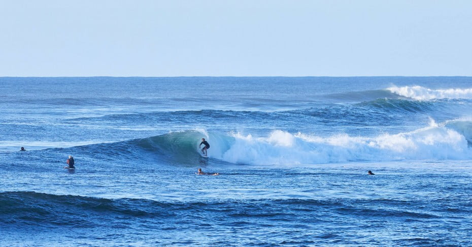 Surfers on Hawaii's North Shore