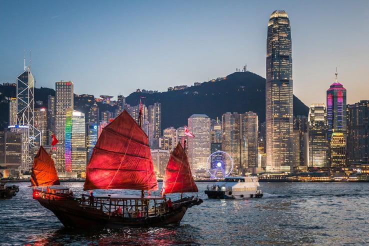 Junk boat sailing across Victoria Harbour, Hong Kong.