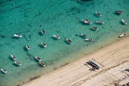 Fishing boats anchored to Nusa Dua, Bali, Asia.