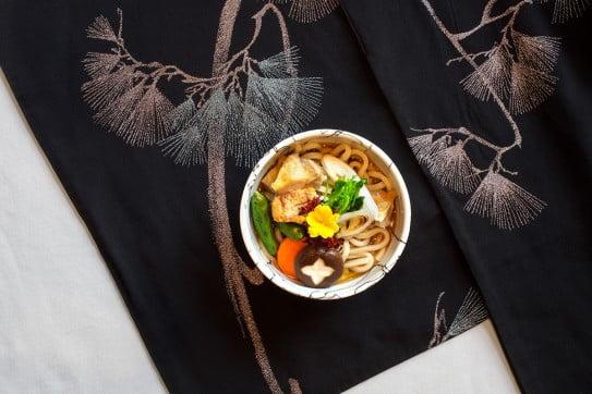 Udon bowl on kimono, Japan.