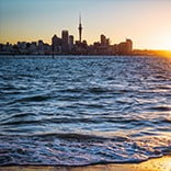 Auckland skyline at sunset, New Zealand.