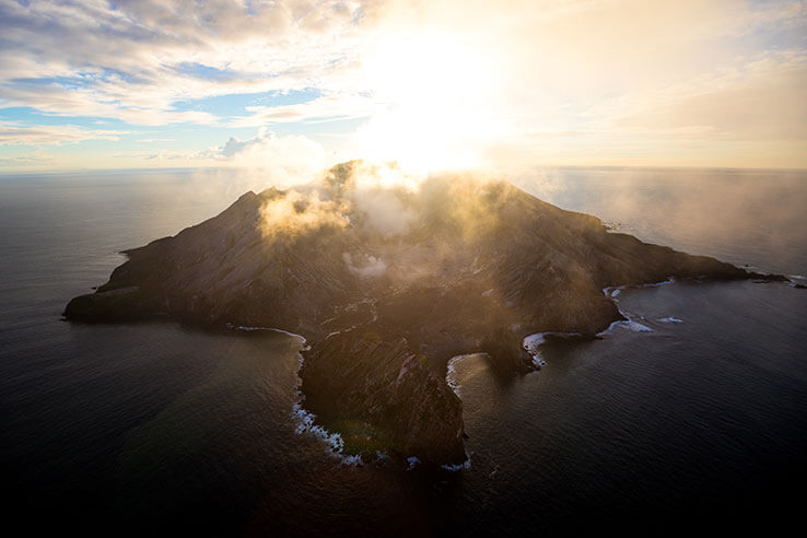 Sunrise over White Island, Bay of Plenty, New Zealand.