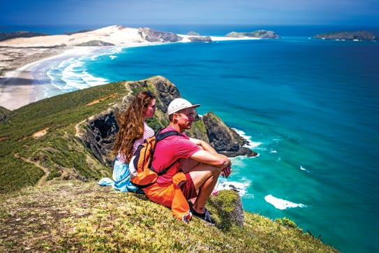 Couple overlooking Cape Reinga lookout.