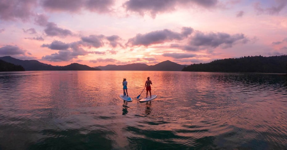Paddle boarding at sunset.