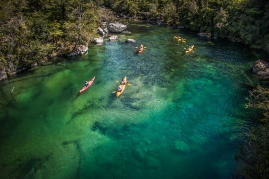 Kayakers in Falls River in Abel Tasman National Park