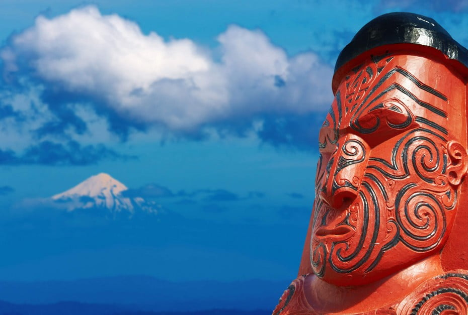 Māori carving and Mt Taranaki, New Zealand.