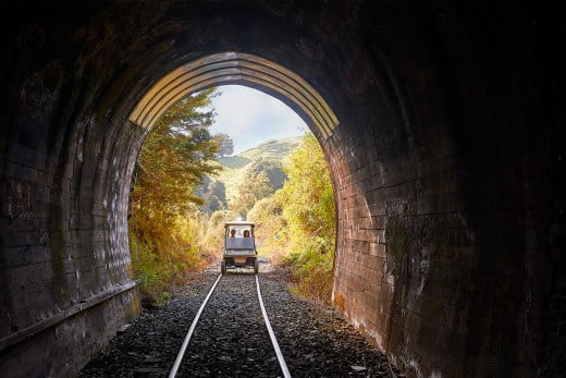 Rail cart tours going through a tunnel, Forgotten World Adventures, New Plymouth/Taranaki, New Zealand.