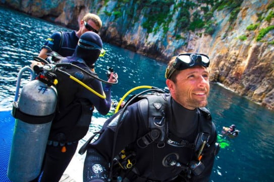 divers at poor knights islands northland