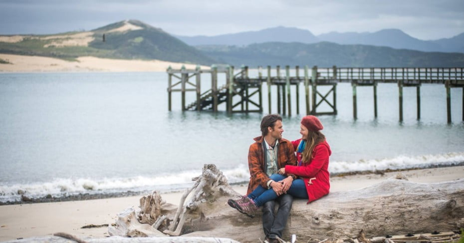 couple on the beach hokianga northland