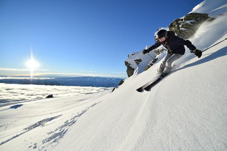 Woman skiing, Cardrona Alpine Resort, Queenstown, New Zealand.