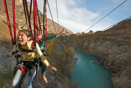 Friends on zipline, Queenstown, New Zealand.