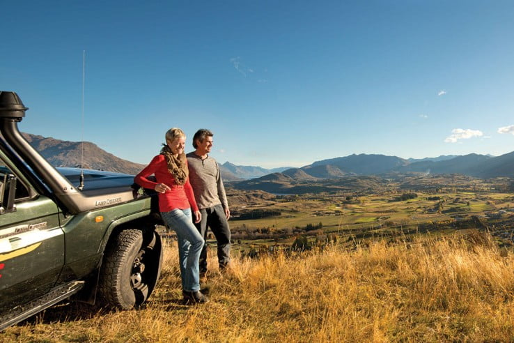 A couple four wheel driving at Tobin's Track, near Arrowtown, Queenstown, New Zealand.