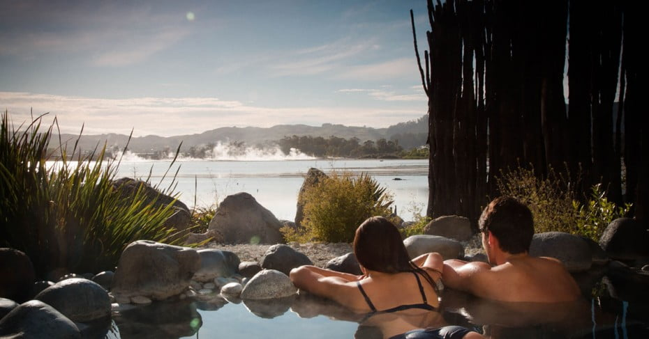 Couple enjoying the hot springs, Rotorua, New Zealand.