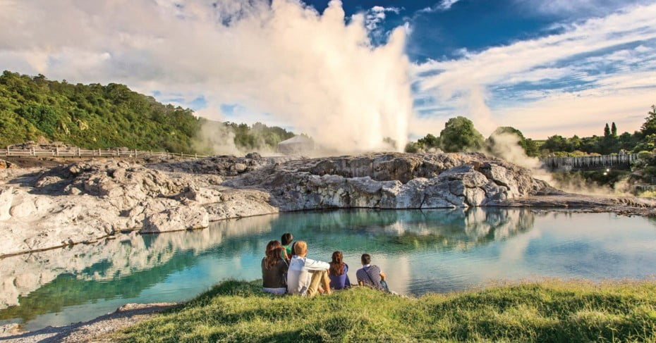 A family observing Te Puia Geothermal Valley, Rotorua.