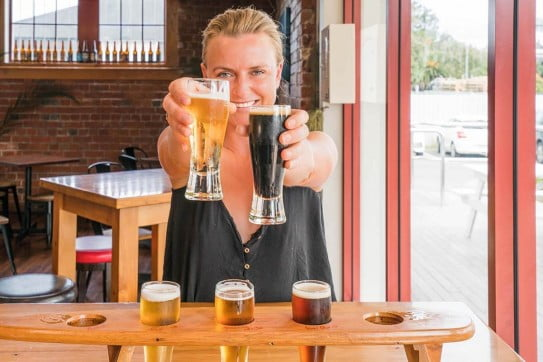 Lady with a beer paddle, beer tasting.