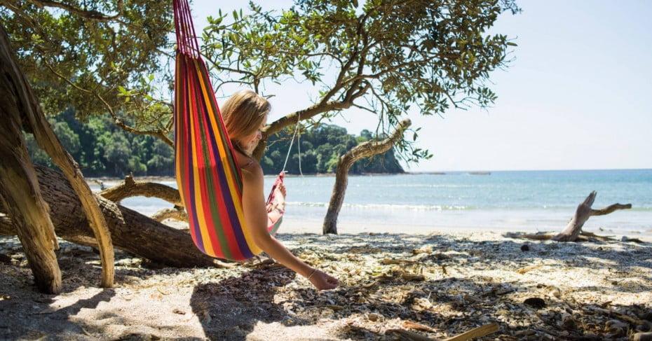 Women relaxing at Otarawairere Bay, Bay of Plenty.