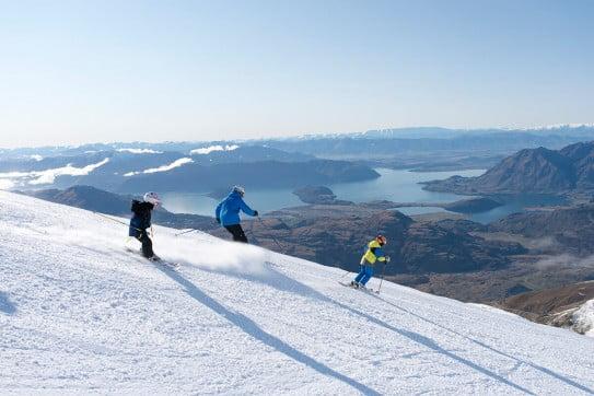 Family skiing at Treble Cone, Wanaka, New Zealand.