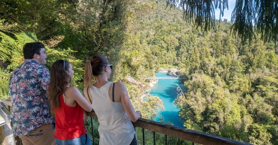 Tourists admiring Hokitika River, West Coast, NZ