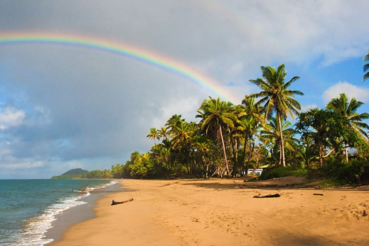 Rainbow on beach, Fiji, Pacific Islands.