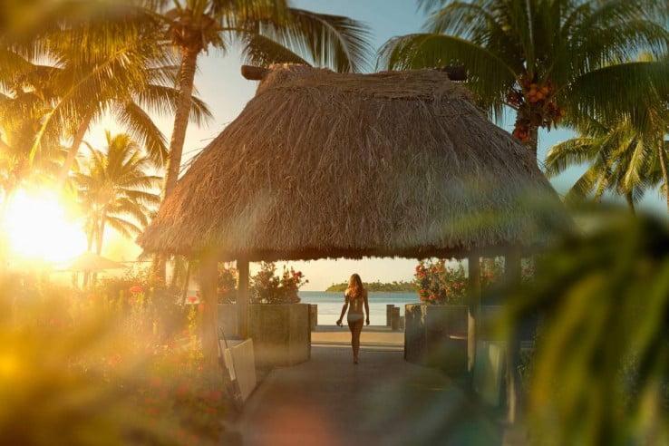 Woman Walking Under Hut in Tropical Beach, Nadi, Fiji