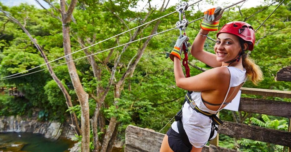 Woman ziplining in Fiji.