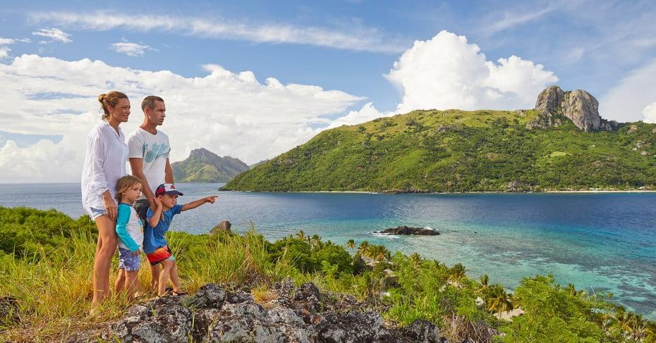 Young family hiking near Sand Cay, Fiji