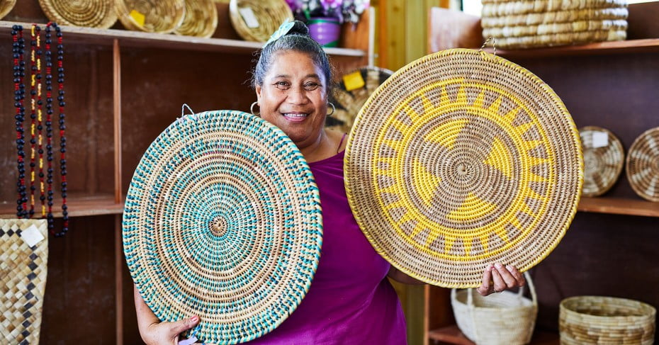 Woman with her weavings, Niue.