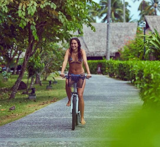 Woman riding bike, Tahiti
